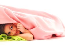 Young girls under blanket smile Stock Image