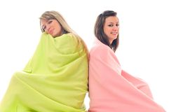 Young girls under blanket smile Stock Images