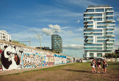 Young girls walking around funny artworks of outdoor East Side Gallery Royalty Free Stock Photos