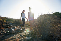 Young girls walking down rocky path Stock Photos