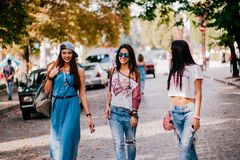 3 young girls walking on the street Royalty Free Stock Photo
