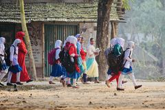 Young girls are walking together to attend the village school. Bangladeshi young children walking together to attend the school isolated unique photograph stock images