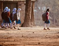 Young girls are walking together to attend the village school. Bangladeshi young children walking together to attend the school isolated unique photograph stock photo