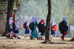 Young girls are walking together to attend the village school. Bangladeshi young children walking together to attend the school isolated unique photograph royalty free stock images