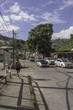 A young girls walks home from school in Maraval, Trinidad stock photos