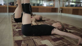 Young girls warm up in the gym. The exercises in rhythmic gymnastics. stock video footage