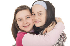 Young girls in warm winter clothes hugging Stock Images