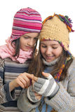 Young girls in warm winter clothes speaking on a mobil Royalty Free Stock Images