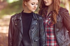 Young girls wearing leather jackets. Close-up of young girls wearing leather jackets. Lesbian relationship concept Royalty Free Stock Photo