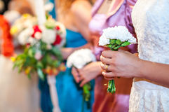 Young girls at wedding reception holding flowers Royalty Free Stock Photography
