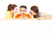 Young girls whisper to the man with shocking events Royalty Free Stock Photo