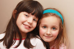 Young girls who are sisters and friends Stock Photos