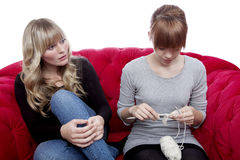 Young girls wondering about knitting Stock Photos