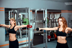 Young girls workout in the gym Stock Image