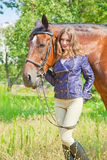Young girlwith a horse. Stock Photos