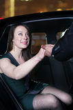 Young, glamorous woman being helped out of her car at a red carpet event in Beijing Royalty Free Stock Images