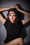 Young glamour lady, dark key studio portrait Royalty Free Stock Photos