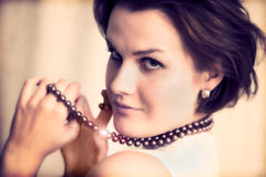 Young glamour lady with necklace Royalty Free Stock Image