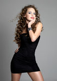 Young glamour girl in black dress Stock Photography
