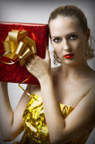 Young glamour woman with christmas gift box Stock Photos