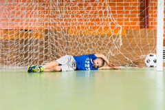 Young goalkeeper missed the ball Royalty Free Stock Photography