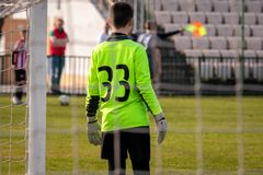 Young goalkeeper is waiting. Teen soccer. Young goalkeeper. Football match. Sport tournament royalty free stock images