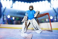 Young goaltender preparing to catch the puck royalty free stock images