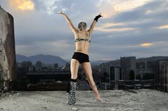 Young gogo dancer girl. On top of the building with city in backgound Royalty Free Stock Photos