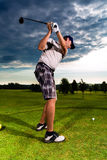 Young golf player on course doing golf swing. He presumably does exercise Stock Image