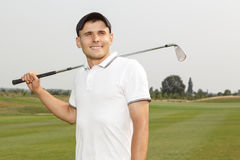 Young golf player holding a niblick. Outdoors Stock Photography