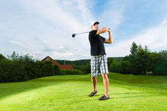 Free Young Golf Player On Course Doing Golf Swing Royalty Free Stock Photos - 27225298