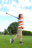 Young golfer. Playing a shot from the fairway Royalty Free Stock Photos