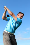 Young golfer. Driving with a wood against cloudy skies Royalty Free Stock Photo