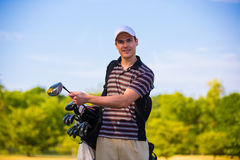 Young Golfer in Early Morning Stock Images
