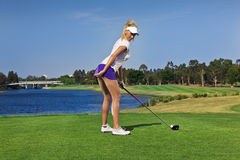 Young golfer girl. Attractive golfer girl on golf course with driver Stock Photos