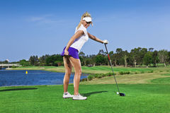 Young golfer girl Royalty Free Stock Image