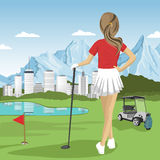 Young golfer girl standing with a golf club looking at lake, city and mountains Stock Photography