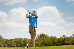 Young Golfer with Good Form Royalty Free Stock Photos
