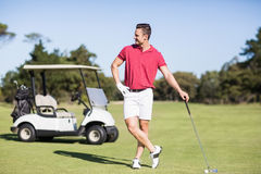 Young golfer with hand on hip Stock Image