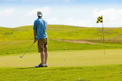 Young golfer on putting green Stock Images
