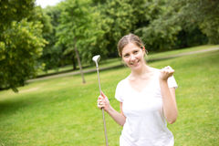 Young golfer. Young woman celebrating a hole in one on the golf course Stock Photo
