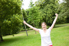 Young golfer. Young woman celebrating a hole in one on the golf course Royalty Free Stock Photos