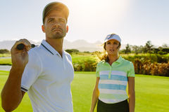 Young golfers at golf course together stock photo