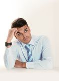 Young good looking business Man thinking, pensive and doubtful Royalty Free Stock Images