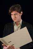 Young good looking man holding folder Stock Photo