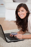 Young good looking woman making a payment Stock Photography