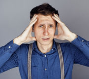 Young goofy man with pimples pointing in studio Stock Photography