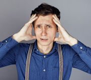Young goofy man with pimples pointing in studio Royalty Free Stock Images