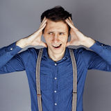 Young goofy man with pimples pointing in studio Royalty Free Stock Photo