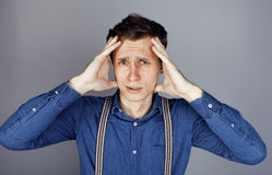 Young goofy man with pimples pointing in studio Stock Image